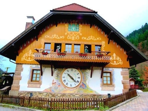 The world's largest cuckoo clock keeps time outside a clockmaker's shop.