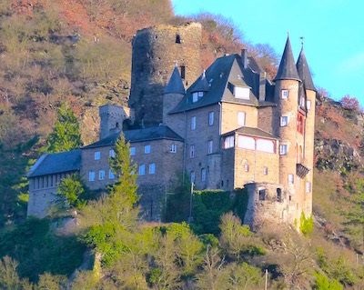 Castles and ruins dot the hillsides of the Rhine River.
