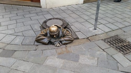 Bratislava monument to working man If you rub his head, money will be yours forever