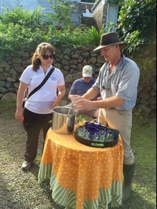 Chef Kellie Evans assists Aragorn Dick-Read in serving tea to our group