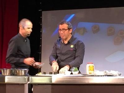 Cooking demo with vegan guest chef Cristopher Berg (left) and Oceania fleet corporate chef Franck Garanger