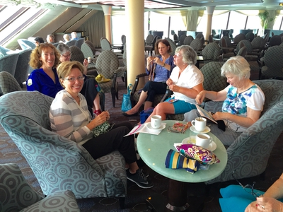 The needlers gather for coffee and chatting during our morning at sea.