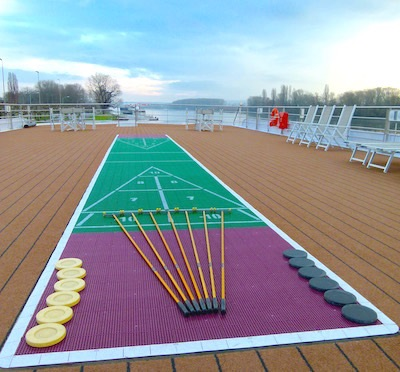 A shuffleboard on the Sun Deck waits for players.