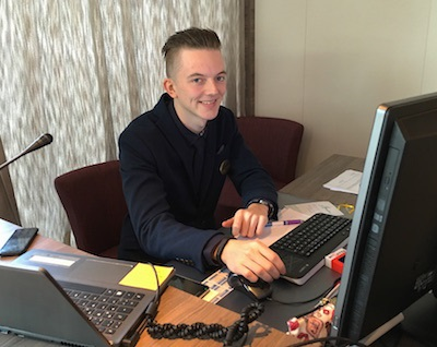 Nico Hagen sits at the very visible cruise director's desk.