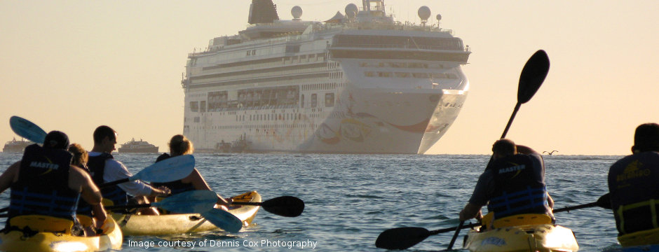 Kayakers and cruise ship at Land's End, Cabo San Lucas, Baja California, Mexico