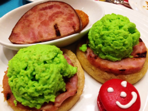 "Green eggs and ham at the Dr. Seuss Breakfast on Carnival Cruise Line ships. ""Would you, could you, on a boat? Try them while you float."""
