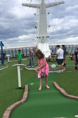 Playing putt-putt on the top of the ship