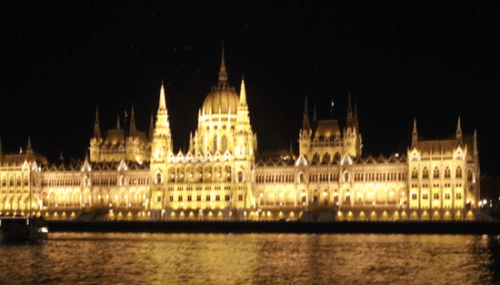 Budapest glows at night from the Danube River