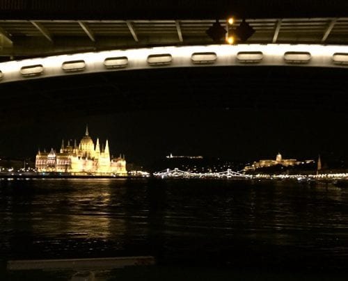 Hungary's Parliament bathed in light under Budapest's Margrit Bridge (Photo by Timothy Leland)