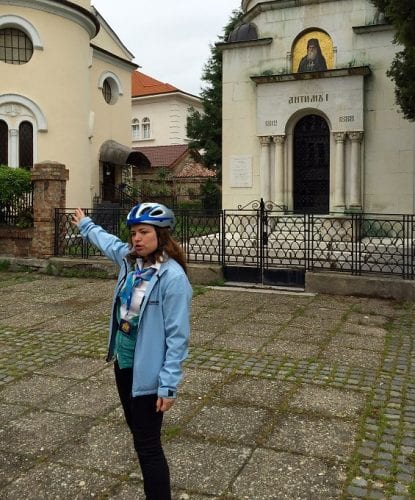 Guide points out church built half underground (red roof)