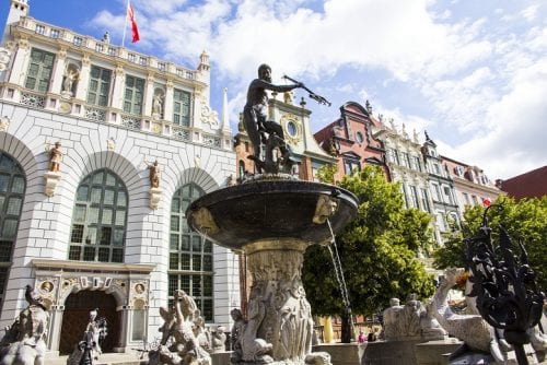 The Fountain of Neptune fronts the magnificent 14th century Baroque-style Palace of Artus Court, the one-time center of Gdansk's Hanseatic mercantile society.