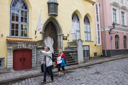 Visitors explore the medieval Old Town center of Tallinn, Estonia.