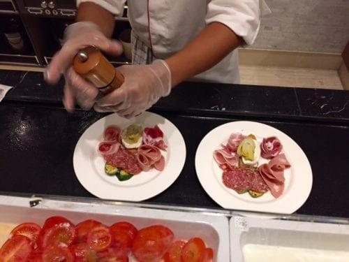 Antipasto appetizer being prepared in Manfredi's