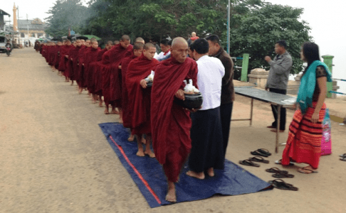 Monks line up for breakfast beside the Irrawaddy, compliments of the crew of Avalon Myanmar
