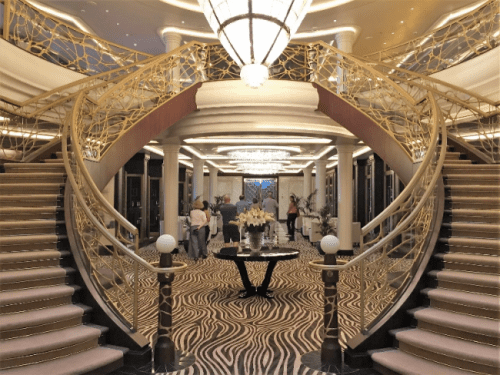 The sophisticated atrium entrance to Compass Rose, main dining room on Seven Seas Explorer (Photo by David G. Molyneaux, TheTravelMavens.com)