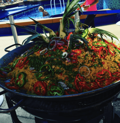 Arroz con pollo ready to be served on the pool deck of the Norwegian Gem