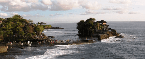 Every day at sunset in Bali, Indonesia, hundreds of Hindu followers and curious travelers gather at Tanah Lot temple, which stands on solid sea rock
