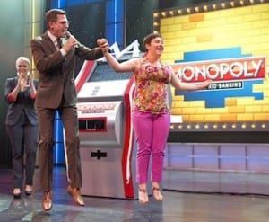 Cruise director Butch Begovich leads a contestant in a Breeze game show. (Courtesy photo)