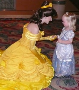 A tiny princess meets Disney's Belle from Beauty and the Beast aboard the Disney Magic.