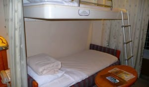 Our cabin aboard the Disney Magic has two twin beds plus a sofa bed and a bunk bed overhead. The cabin attendant prepares the extra beds every night and puts them back in the morning.