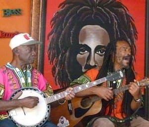 A small band plays Bob Marley music inside the mausoleum compound.
