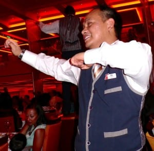 Waiters dance to Gangnam Style in the Blush Restaurant aboard the Carnival Breeze.