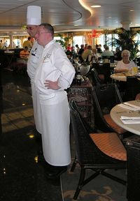 Christophe Belin, Riviera's senior executive chef, right, and Raffaele Saia, Italian Chef de Cuisine, make regular appearances in the Terrace Café to talk with passengers. They also put on an entertaining cooking class.