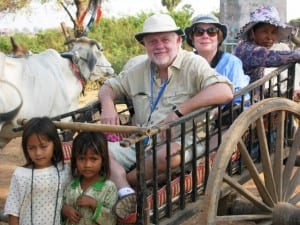 An ox cart ride, with singing, for David Molyneaux and Fran Golden in Cambodia