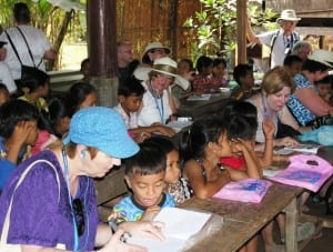 Avalon Angkor passengers join a class learning English in Angkor Ban, Cambodia, after shopping for school supplies that we donated.