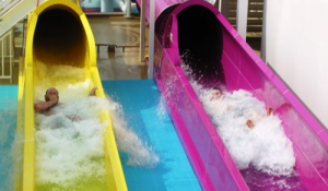 Two of the five water slides on Norwegian Breakaway, where 84 of 4,028 passengers sleep in The Haven, a ship within a ship