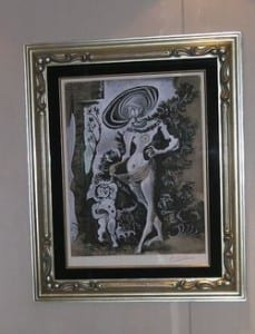 A racy print by Pablo Picasso, one of 16 of his works aboard Riviera, is tucked away at the entrance to the ladies room outside the Grand Dining room on Deck 6