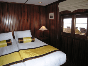 One of the rear cabins on Avalon Angkor, with windows toward the aft end