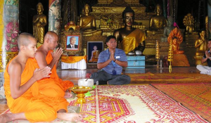 Traditional water blessing by Buddhist monks, with guide Wanty in the middle