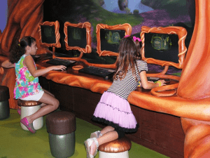 In Pixie Hollow, land of Tinker Bell, children sit on stools shaped like mushrooms and acorns to make crafts