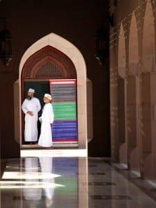 Two men in Sultan Qaboos Mosque, Muscat, Oman