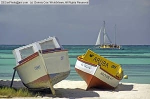 Aruba: Colorful boats on white sand beach