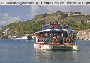 Harbor at Saint George's with Rhum Runner sightseeing boat and Fort George in background