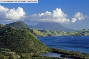 Saint Kitts and Nevis: View from southeast peninsula of Saint Kitts across The Narrows toward cloud-capped Nevis Peak