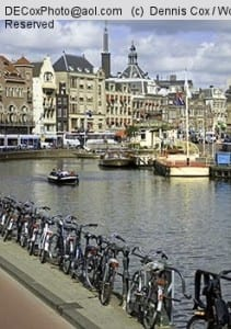Bicycles line the bank of the Amstel River in Amsterdam