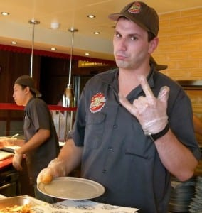 """Greaser"" fixes a burger for cruisers at Guy Fieri's."