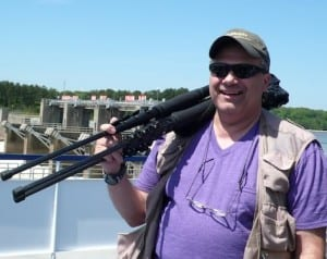 Joe Restuccia III shares photo tips with passengers aboard the Grande Caribe.