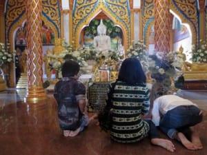 Worshipers pray at Wat Chalong in Phuket