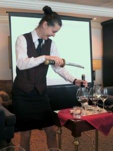 "Cellar Master Preslava Ilieva prepares to ""uncork"" a bottle of champagne with her sabre"