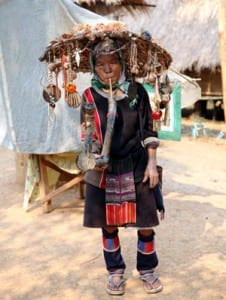 A woman in the traditional dress of the Akha Tribe, originally from Tibet. The village is outside Chiang Rai