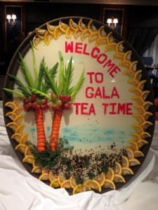 "Lemons, carrots, grapes and radishes welcome guests to ""Gala Tea Time"""