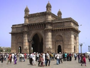 The Gateway of India arch is admired by local families on a Sunday