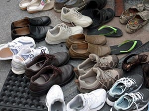 Buddhist religious tradition and the site's popularity are reflected in the hundreds of visitors' shoes outside the Temple of the Emerald Buddha
