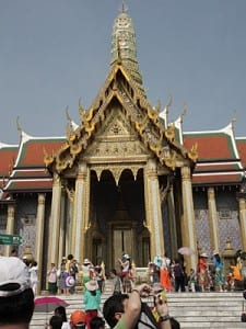Visitors approach the Temple of the Emerald Buddha