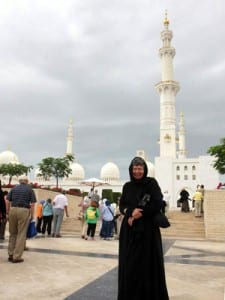 Janet, appropriately attired to enter he Sheikh Zayed Mosque