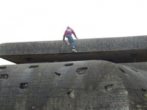 Kids climb on one of the many fortifications of the Atlantic Wall near Omaha Beach